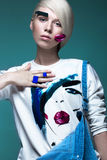 Fashionable girl: natural make-up, clothes with picture in style of pop art. Creative image. Beauty face. Stock Image
