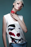 Fashionable girl: natural make-up, clothes with picture in style of pop art. Creative image. Beauty face. Stock Photo