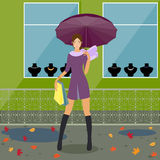 Fashionable girl near the store. Fashionable girl with umbrella stending near the store Stock Image