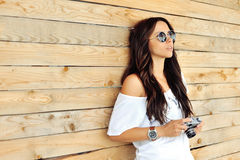 Fashionable girl with old camera Royalty Free Stock Photography