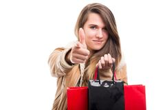 Fashionable girl with paper bags indicate you Stock Image