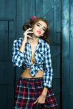Fashionable girl with phone Royalty Free Stock Images
