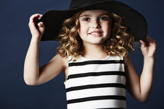 Fashionable girl posing in hat Stock Photos