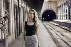 Fashionable girl posing on railway. Royalty Free Stock Images