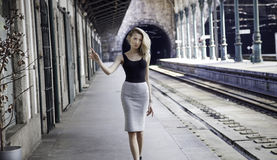 Fashionable girl posing on railway. Stock Photo