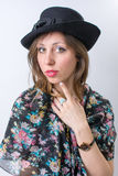 Fashionable girl posing wearing a black hat Royalty Free Stock Images