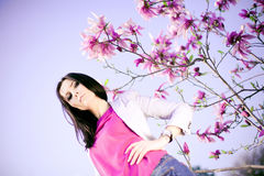 Fashionable Girl and  purple flowers Royalty Free Stock Photography
