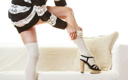 Fashionable girl puts on woolen stockings Royalty Free Stock Photo