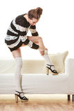 Fashionable girl puts on woolen stockings Stock Images