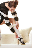 Fashionable girl puts on woolen stockings Royalty Free Stock Photos