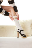 Fashionable girl puts on woolen stockings Stock Image
