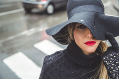 Fashionable girl on a rainy day Royalty Free Stock Photo