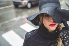Fashionable girl on a rainy day. Fashionable girl walking on a rainy day Royalty Free Stock Photo