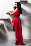 Fashionable girl in red dress near steps Stock Photo