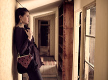 Fashionable girl and retro corridor Stock Photo