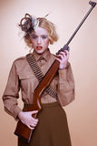 Fashionable Girl Scout Holding Rifle Stock Photography