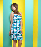 Fashionable girl in a short dress Stock Images