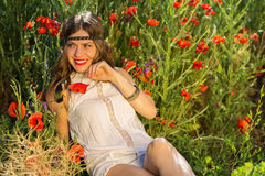Fashionable girl in the summer field Stock Photo