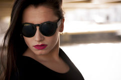 Fashionable girl with sunglasses Royalty Free Stock Image
