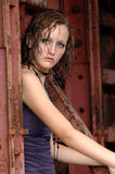 Fashionable girl with wet hair. A beautiful girl with wet hair wearing a party dress and necklace Stock Photo
