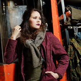 Fashionable girl and working machine Royalty Free Stock Images