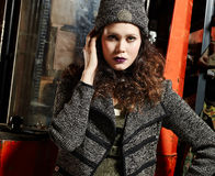 Fashionable girl and working machine Royalty Free Stock Photo