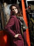 Fashionable girl and working machine Stock Image