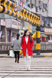 Fashionable girl on zebra crossing, Yiwu, China stock photography
