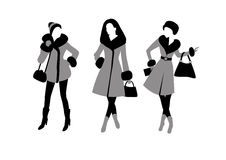 Fashionable girls in outer clothing with bags Stock Image