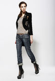 Fashionable Glamorous Woman In Jeans And High Boots. Vogue Style Stock Image