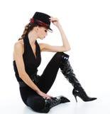 Fashionable glamour girl. Bright shine glamour girl with stylish hat and fashionable jackboots Stock Photo