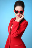 Fashionable glamour trendy brunette wearing in heart sunglasses Royalty Free Stock Image