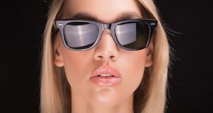 Fashionable glasses on blond girl royalty free stock photo
