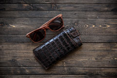 Fashionable glasses with a leather holster on wooden background close-up royalty free stock images