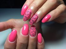 fashionable glossy and matte pink manicure stock images