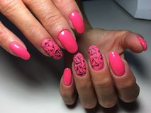 fashionable glossy and matte pink manicure stock photo