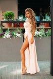 Fashionable and gorgeous girls wearing rose elegant evening dresses.
