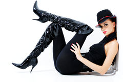 Fashionable gorgeous woman. Glamour fashionable gorgeous woman with black style - indoors Royalty Free Stock Image