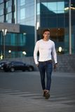 Fashionable guy is the evening city. Trendy handsome guy is the evening city Royalty Free Stock Images