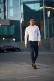 Fashionable guy is the evening city. Trendy handsome guy is the evening city Royalty Free Stock Photography