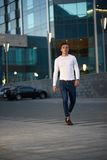 Fashionable guy is the evening city Stock Photography