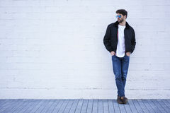 Fashionable Guy In Light Jeans, A White T-shirt And A Dark Jacket For Your Advertising Text Message Or Promotion Royalty Free Stock Photography
