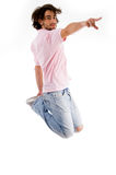 Fashionable guy jumping high in the mid air Stock Image