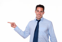 Fashionable guy pointing to his right Royalty Free Stock Photo