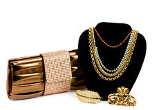 Fashionable handbag and golden jewelry Royalty Free Stock Photography