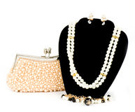 Fashionable handbag and pearl jewelry Royalty Free Stock Photo