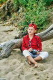 Fashionable handsome boy on a summer walk . Rest and travel . Child posing with an old camera stock photo