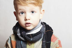 Fashionable handsome little boy in scarf.stylish haircut.fashion Royalty Free Stock Photography