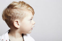 Fashionable handsome little boy. stylish haircut. fashion child Stock Photo