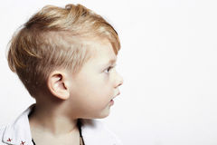 Fashionable handsome little boy. stylish haircut. fashion child Royalty Free Stock Images